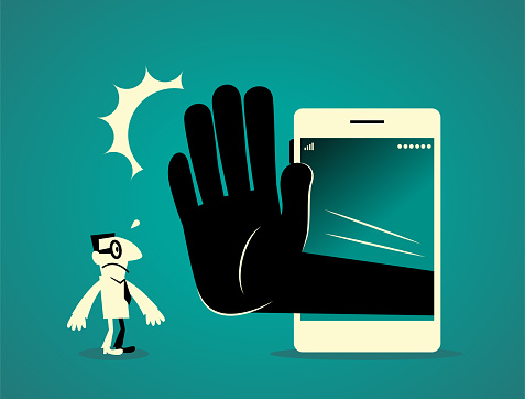 Businessman standing in front of a big smart phone (mobile phone) with a big hand making stop gesture (No!)