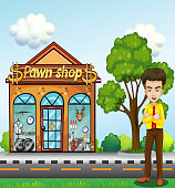 businessman standing in front of the pawnshop