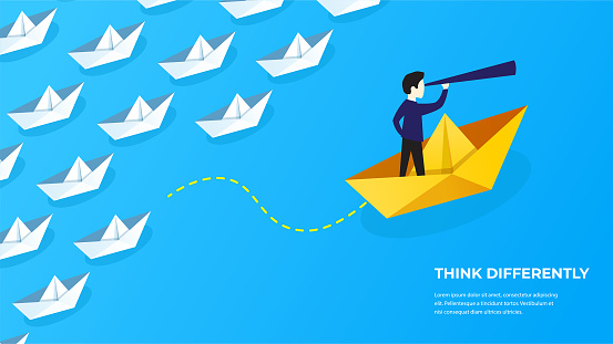 Businessman standing on a paper boat floating in the sea