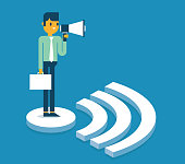 Businessman holding a megaphone standing on WIFI