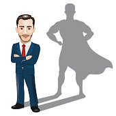 Businessman Standing with His Arms Folded with Superhero Shadow Concept