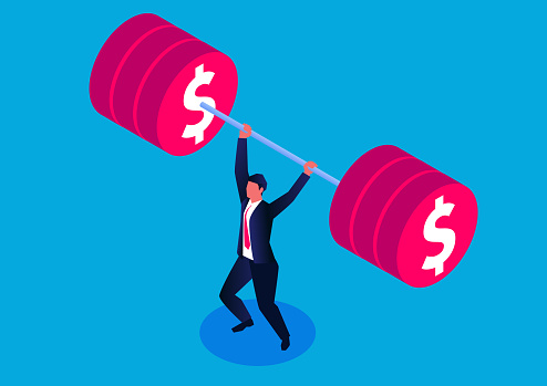 Businessman successfully lifting weights
