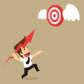 businessman throwing arrows into the target flying