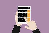 istock Businessman uses a calculator 1209991023