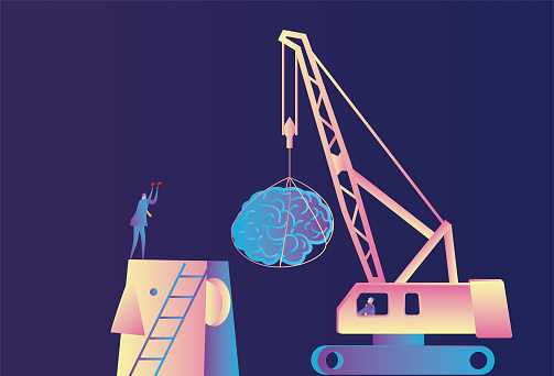 Businessman uses a crane to install the brain for the giant
