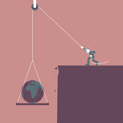 A businessman uses a pulley to lift the earth.