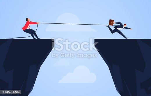 Businessman uses a rope to pull his companion to the cliff