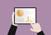 istock Businessman uses a tablet for analysis of business data 1213891613