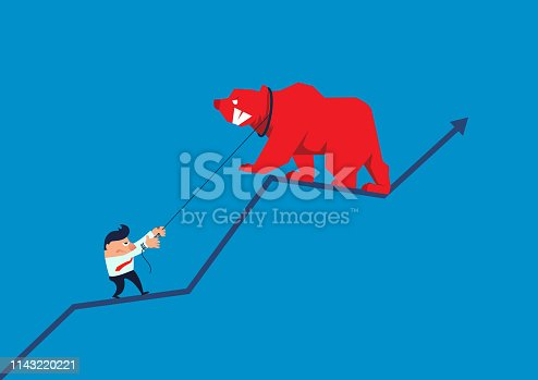 Businessman using rope to pull the arrow on the bear