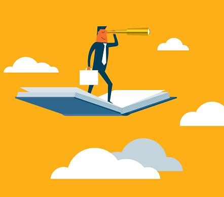 Businessman using telescope on flying book