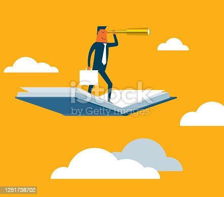 istock Businessman using telescope on flying book 1251738702