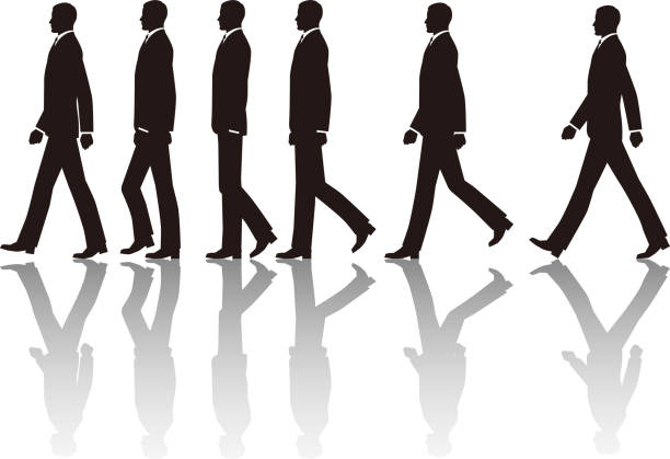 A businessman walking in one direction vector art illustration