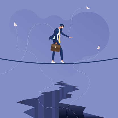 Businessman walking on a tight rope above a crack-Business overcoming difficulties