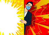 Handsome young businessman wearing face mask behind big empty banner with copy space. Comic book style cartoon vector illustration.