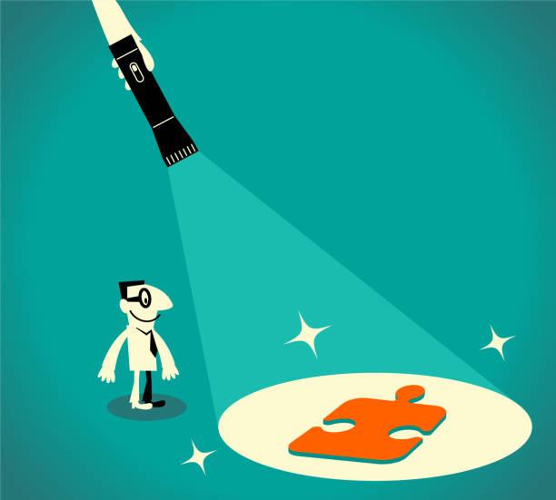 geschäftsmann mit taschenlampe und jigsaw puzzle-stück, kerl, geführt von einer großen hand hält eine taschenlampe - schlüsselfertig stock-grafiken, -clipart, -cartoons und -symbole