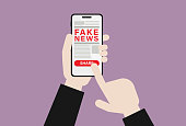 istock Businessman with mobile phone shares fake news 1195910993