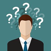 Businessman with question marks