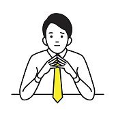 Businessman with steepled hands