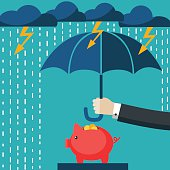 Businessman with umbrella protecting his piggy bank. Saving money concept