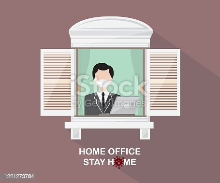 istock A businessman working at home looking out the window. Curfew and home quarantine. Work from home. 1221273784