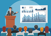 Businessmen giving speech or presenting charts on a whiteboard in meeting room. Business seminar and presentation concept.