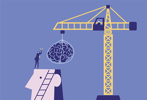 Businessmen use cranes to install brains for giants