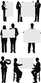 Businesspeople holding poster signs