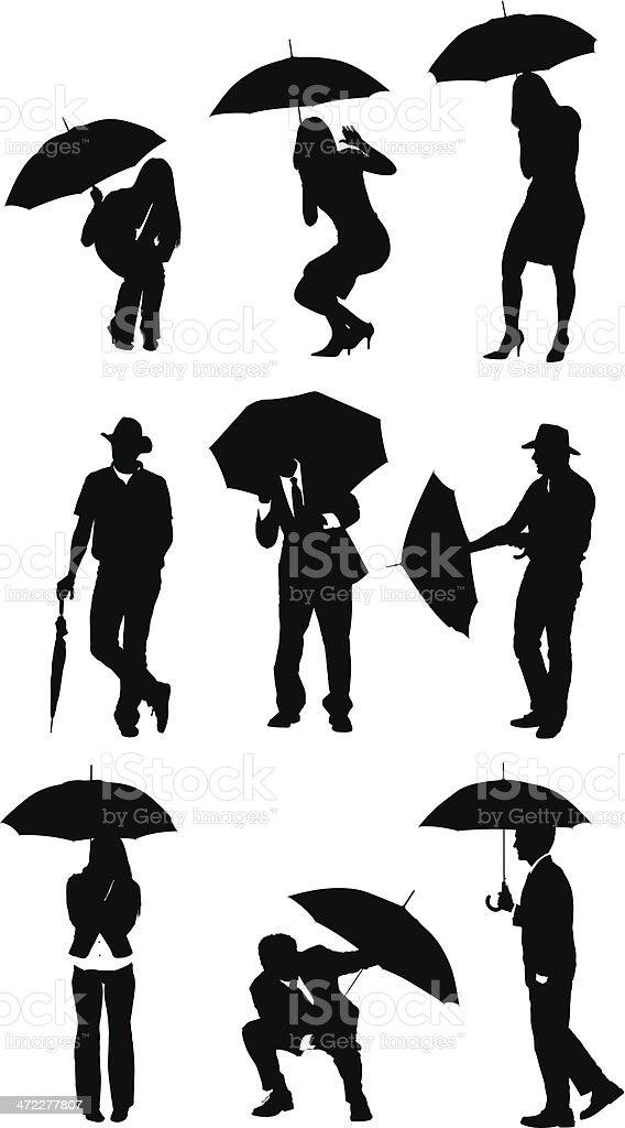 Businesspeople using umbrellas vector art illustration