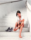Stipple illustration of a tired, worried businesswoman with sore feet.
