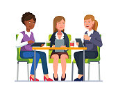 Three business woman, sitting at desk together with their gadgets talking, having coffee break. Woman coworkers group chatting and tapping tablet computers at meeting. Flat vector character illustration isolated on white background.