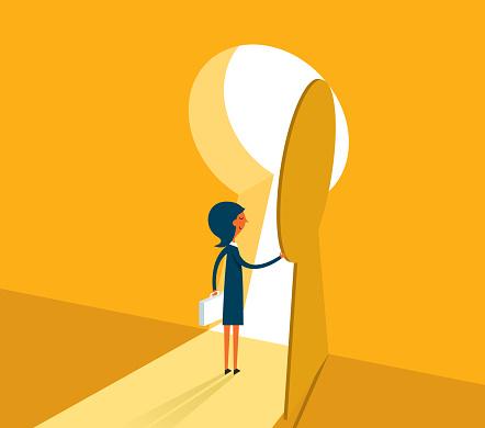 Businesswoman entering keyhole