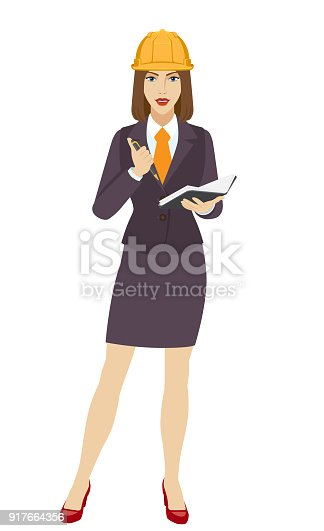 istock Businesswoman in construction helmet with pen and pocketbook 917664356