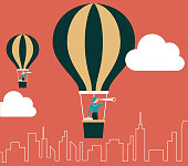 businesswoman in hot air balloons looking for opportunities