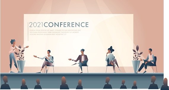 Businesswoman introduces panel of experts during conference