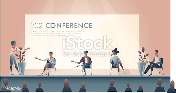 istock Businesswoman introduces panel of experts during conference 1260407434