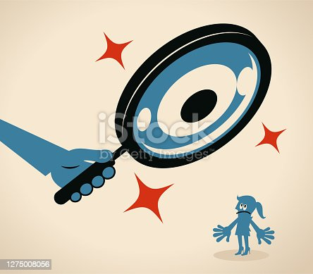 istock Businesswoman is being watched by a big magnifying glass with eyes 1275008056