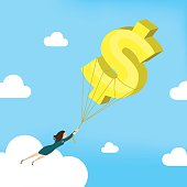 Businesswoman is flying with dollar sign balloon