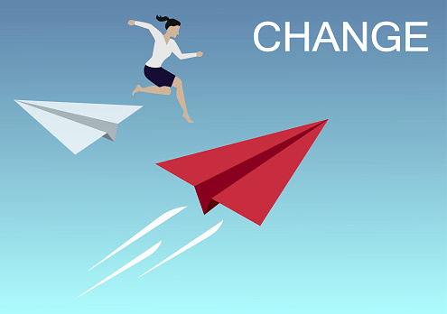 Businesswoman jump from white origami paper airplane to red for change direction. Business Concept of changing.
