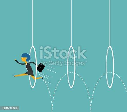 Businesswoman jumping through hoops