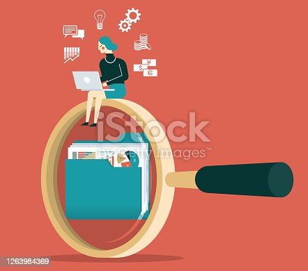 istock Businesswoman - Looking for documents 1263984369