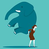 A businesswoman carrying an elephant on his back and moving with determination.