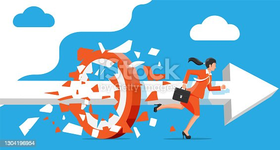 istock Businesswoman running and breaking target. 1304196954