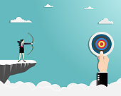 Vector illustration flat. Businesswoman standing on cliff with archer in hand. Business target goals concept. Businesswoman focus to successful. Shooting target with bow and arrow