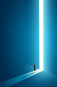 Businesswoman walking go to front of bright big shining door in the wall darke blue of the hole at light falls. illustration Vector
