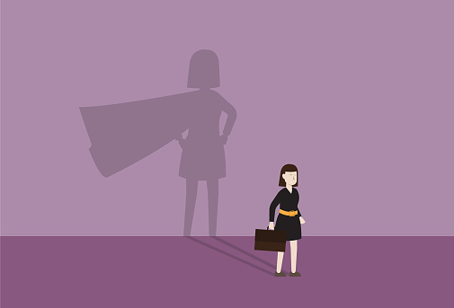 Businesswoman with a cape shadow