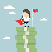 Businesswoman with winners flag standing on money stairs.