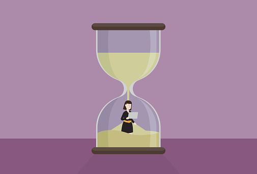 Businesswoman work in an hourglass