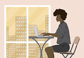 Business woman working in the office during big city sunset