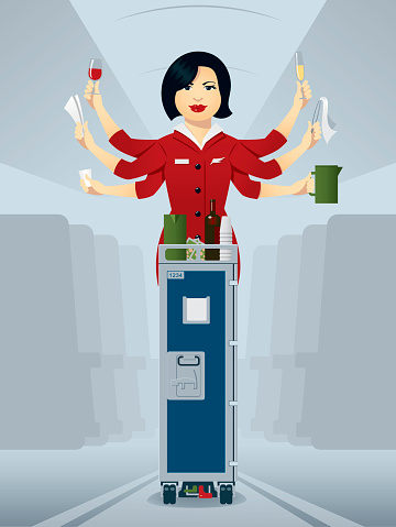Busy flight attendant, serving drinks of the trolley