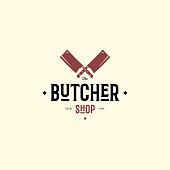 Emblem of Butcher meat shop with knives, text The Butcher Meat Shop. emblem template for meat business - shop, market, restaurant or design - banner, sticker. Vector Illustration